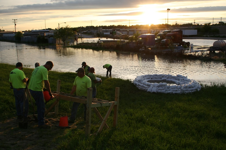 Crews fill sandbags to construct a ring around boils on a Sand Creek Levee in Lincoln, Nebraska, following record rainfall on May 6, 2015.