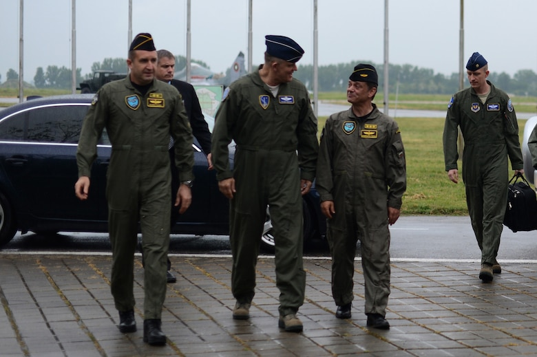 U.S. Air Force Gen. Frank Gorenc, U.S. Air Forces in Europe and Air Forces Africa commander, converses with U.S. and Bulgarian Air Force leaders after arriving at Graf Ignatievo Air Base, Bulgaria, May 11, 2015. Gorenc visited the base to speak with U.S. and Bulgarian Airmen about the joint training occurring as part of a Theater Security Package deployment of Airmen from the 159th Expeditionary Fighter Squadron. (U.S. Air Force photo by Senior Airman Gustavo Castillo/Released)