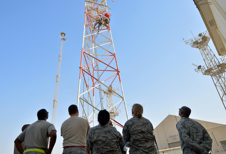 Base personnel observe a climbing demonstration in support of the Air Force fall protection focus initiative at an undisclosed location in Southwest Asia May 11, 2015. According to the Air Force Safety Center website, The Fall Protection Focus alerts the entire Air Force family - active duty, civilian, Guard, Reserve and family members - of what can be done to prevent fall-related injuries and deaths. (U.S. Air Force photo/Tech. Sgt. Jeff Andrejcik)