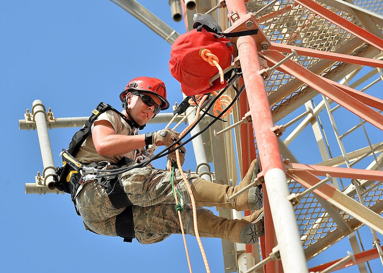 Senior Airman Eric, Cable Maintenance journeyman, , climbs a communication tower as part of a demonstration in support of the Air Force fall protection focus initiative at an undisclosed location in Southwest Asia May 11, 2015. According to the Air Force Safety Center website, the Air Force experiences hundreds of fall mishaps annually that result in thousands of lost man-hours as well as injuries and deaths. (U.S. Air Force photo/Tech. Sgt. Jeff Andrejcik)