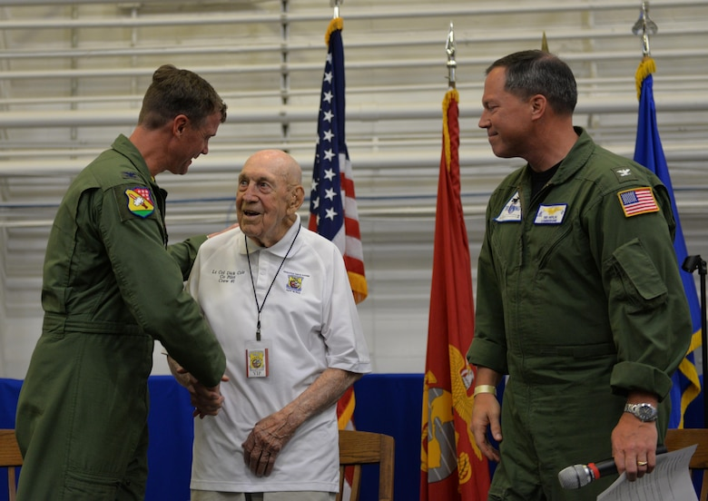 Retired Lt. Col. Dick Cole, a Doolittle Raider, greets Col. Thomas Shank, 479th Flying Training Wing commander, and Capt. Edward Heflin, 6th Training Air Wing commodore, at the Doolittle Raiders ceremony at Naval Air Station Pensacola May 8, 2015. Cole was Lt. Col. Jimmy Doolittle's co-pilot during the Doolittle Raid over Tokyo April 18, 1942. (U.S. Air Force photo/1st Lt. Ben Sowers)
