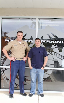 Dylan DeYoung, a poolee with Permanent Contact Station Smithfield, poses for a picture with U.S. Marine Corps Staff Sgt. Michael L. Block, a recruiter, outside of PCS Smithfield, North Carolina, April 29, 2015. DeYoung lost more than 70 pounds over the course of 17 months to join the Marine Corps. (U.S. Marine Corps photo by Sgt. Dwight A. Henderson/Released)