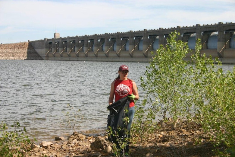 JOHN MARTIN RESERVOIR, Colo. – A volunteer picks up trash near the dam, May 2, 2015.