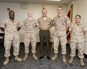 U.S. Marine Corps, Commandant of the Marine Corps (CMC), Gen. Joseph Dunford sits with the Marine Corps Warfighting Laboratory (MCWL) on Marine Corps Base Quantico, May 6, 2015. The CMC met with the Marines and the civilians of the command. (U.S. Marine Corps photo by Lance Cpl. Jacqueline A. Garcia/ Released)