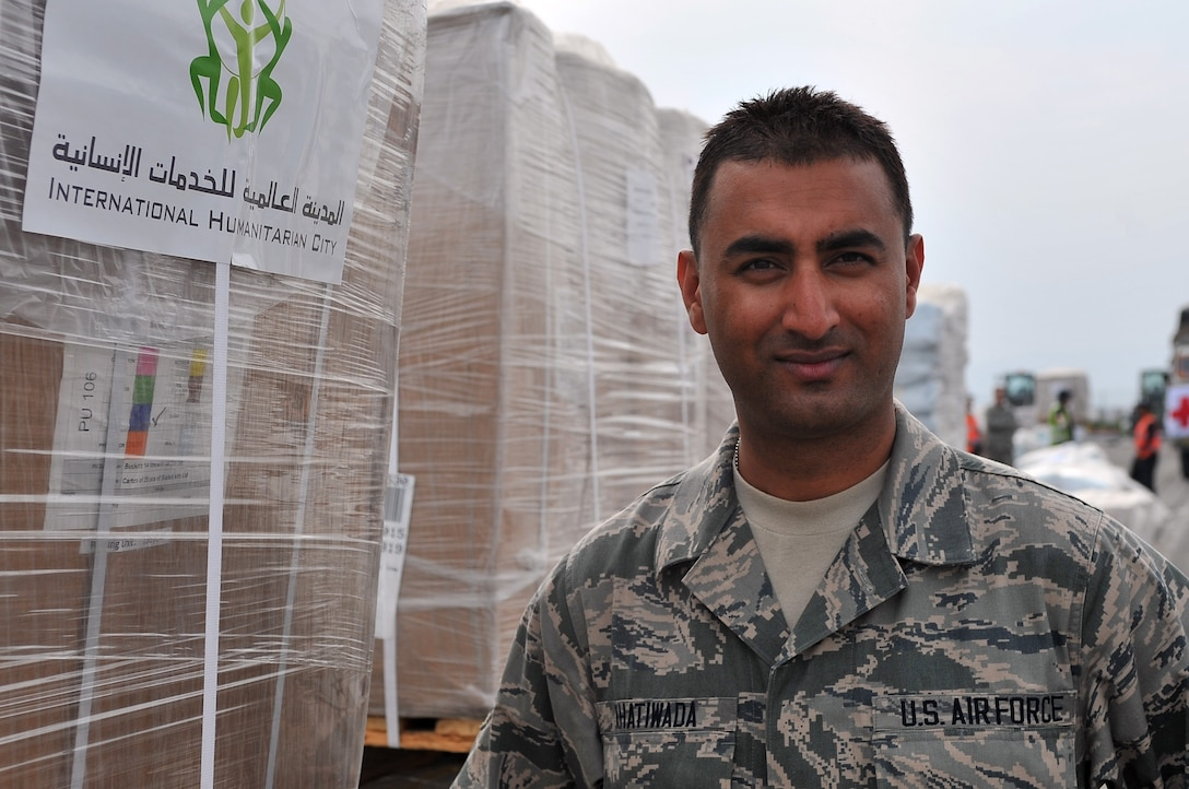 Senior Airman Manoj Khatiwada, a 21st Medical Operations Squadron aerospace medical technician, stands in front of a pallet of humanitarian assistance and disaster relief supplies at Tribhuvan International Airport in Kathmandu, Nepal, May 8, 2015. Four days after the earthquake in Nepal, Khatiwada was on a C-17 Globemaster III with members of the 36th Contingency Response Group on their way to Nepal. (U.S. Air Force photo/Staff Sgt. Melissa White)