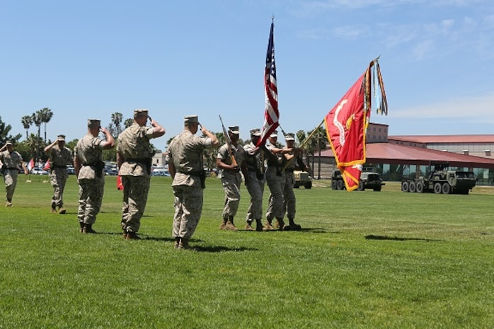 Commanding Officer and Sergeant's Major render honors to the National Ensign and Marine Corps Colors.
