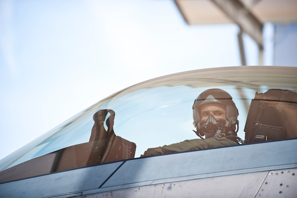 Col. Adrian Spain, U.S. Air Force Weapons School commandant, preps for his final flight as the USAFWS commandant at Nellis Air Force Base, Nev., May 11, 2015. Spain has served as the commandant of the USAFWS since June 2013. (U.S. Air Force photo by Staff Sgt. Siuta B. Ika)