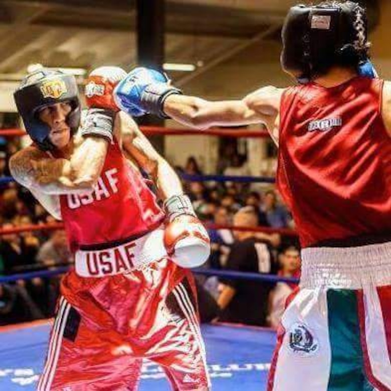 Senior Airman Kenneth De Jesus-Cruz, 9th Aircraft Maintenance Squadron cyber transport technician, dodges a punch thrown from Angel Garcia of Advocates Boxing during the Golden Glove tournament in San Antonio, Feb. 19, 2013. Cruz won this fight in a 3-2 decision. (Courtesy photo)