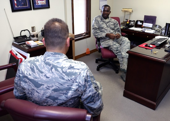 ALTUS AIR FORCE BASE, Okla. – U.S. Air Force 1st Lt. Emmanuel Enoh, 97th Air Mobility Wing chaplain, speaks with an Airman during a confidential counseling session at the chapel, May 7, 2015. Chaplains maintain a presence with the Airmen on base in a variety of ways, such as spiritual resilience retreats and base events, counseling services and squadron visits. (U.S. Air Force photo by Airman 1st Class Megan E. Acs/Released)