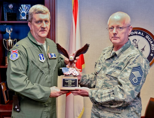 Col. Scott Grant, 117th Air Refueling Wing Vice Commander and Chief Master Sgt. David Wright Displays the CSM Wallace J Paschal Enlisted National Guard Association of Alabama Award for having more elisted members than any other unit in Alabama. The award was presented to the 117 ARW during a conference on April 25, 2015.  (U.S. Air National Guard photo by: Senior Master Sgt. Ken Johnson/Released)