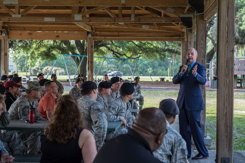 Sheriff of Charleston County, James Cannon Jr., speaks to a group of defenders from the 628th Security Forces Squadron May 11, 2015 at Joint Base Charleston, S.C. Cannon's presentation  started the 2015 National Police Week celebration. Each year police week is held to honor those who have made the ultimate sacrifice in the line of duty. Cannon, a retired colonel from the Air Force Reserve, shared a few words of wisdom and offered his gratitude to the men and women who protect the installation as well as the many people who work and live on Joint Base Charleston. Events for this year's police week include a picnic, a 24-hour ruck march and a retreat ceremony.  (U.S. Air Force photo/Senior Airman Jared Trimarchi)