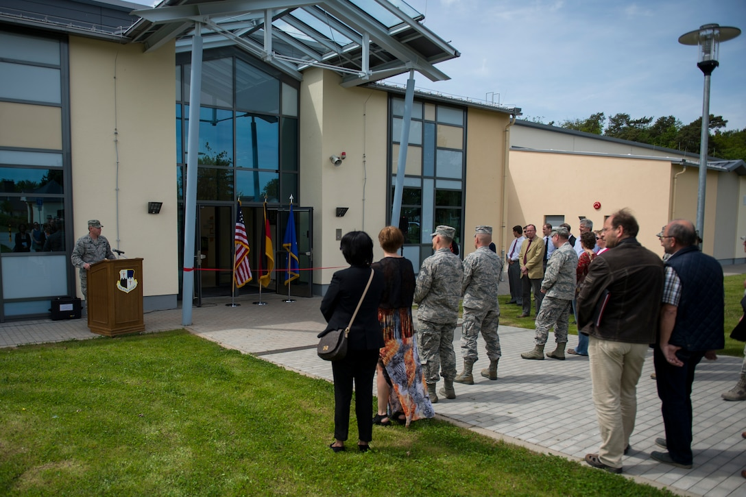 U.S. Air Force Col. Joe McFall, 52nd Fighter Wing commander, speaks to 52nd FW leadership and key community members during the official opening of the new child development center at Spangdahlem Air Base, Germany, May 11, 2015. More than 40 people were in attendance to celebrate the opening of the new facility. (U.S. Air Force photo by Airman 1st Class Luke Kitterman/Released)