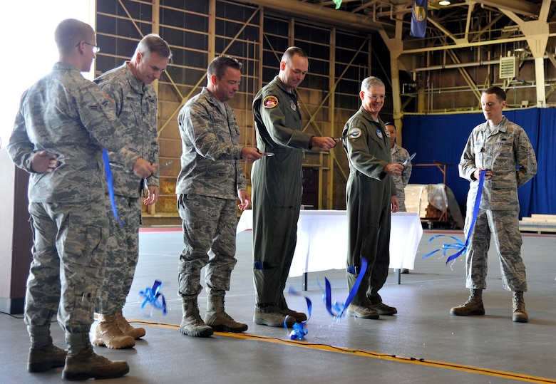 U.S. Air Force Lt. Gen. Sam Angelella, U.S. Forces Japan and 5th Air Force commander, conducts a ribbon cutting ceremony for the Type III Hydrant System alongside base leadership at Misawa Air Base, Japan, May 11, 2015. The hydrant system was constructed to allow Misawa the capability to host a larger fleet of aircraft more efficiently. This system was completed after a two-year process from planning to completion. (U.S. Air Force photo by Senior Airman Patrick Ciccarone/Released)