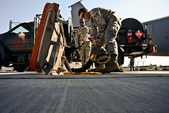 U.S Air Force Airman 1st Class David Works, 35th Logistics Readiness Squadron fuels distribution operator, hooks up a fuel hose to the newly installed Type III hydrant system at Misawa Air Base, Japan, May 11, 2015. Misawa hosted a ceremony recognizing the installation of the new system, which feeds fuel to aircraft from an underground tank. (U.S. Air Force photo by Staff Sgt. Derek VanHorn/Released)