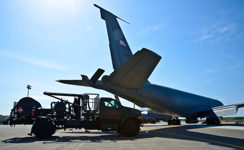An R-12 fuel servicing truck approaches a KC-135 Stratotanker to conduct aircraft refueling at Misawa Air Base, Japan, May 11, 2015. The R-12 vehicles hook up to a newly installed Type III hydrant system and feeds fuel from underground tanks straight into the aircraft. (U.S. Air Force photo by Staff Sgt. Derek VanHorn)