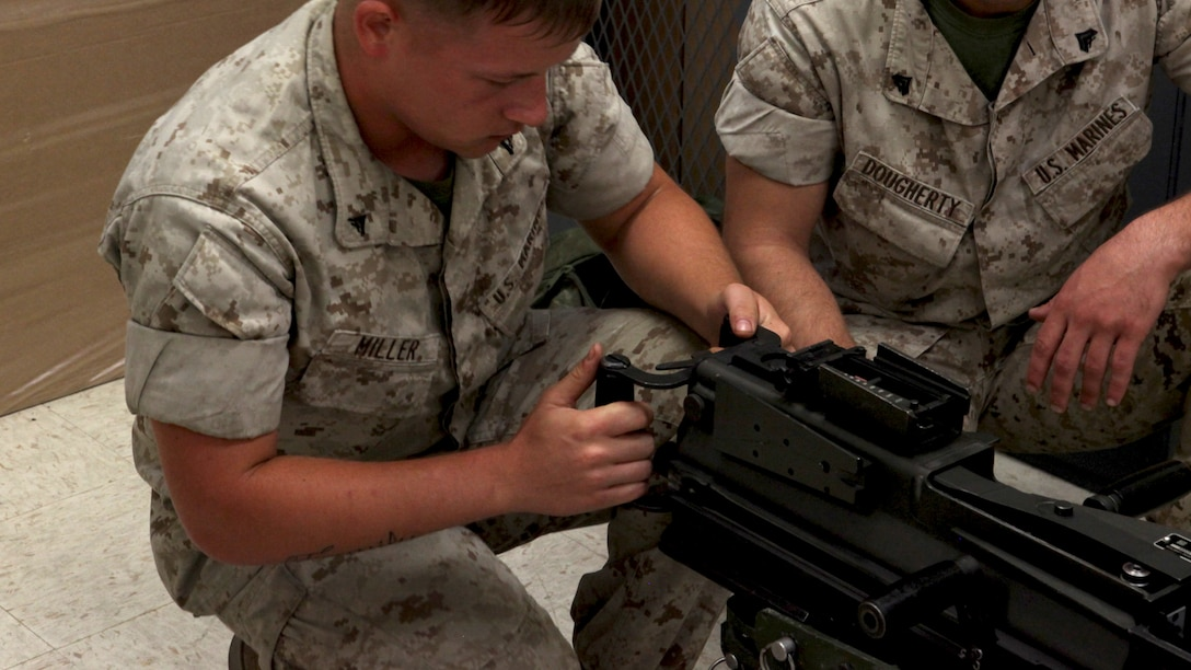 Lance Cpl. Zachary Miller, a motor vehicle operator with 2nd Light Armored Reconnaissance Battalion, 2nd Marine Division function checks a Mk-19 automatic grenade launcher during a Machine Gunners Course at the Division Combat Skills Center aboard Marine Corps Base Camp Lejeune, North Carolina, April 15, 2015. During the course the Marines were trained how to properly disassemble, reassemble and maintain the M249 squad automatic weapon, the M240B machine gun, Browning M2 .50 caliber machine gun and the MK19 automatic grenade launcher. (U.S. Marine Corps photo by Pfc. David N. Hersey/Released)