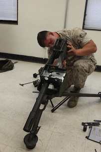 Lance Cpl. Christian Herbeck, a motor vehicle operator with 2nd Light Armored Reconnaissance Battalion, 2nd Marine Division, reassembles a Mk-19 automatic grenade launcher during a Machine Gunners Course at the Division Combat Skills Center aboard Camp Lejeune, N.C., April 15, 2015. During the course, the Marines were trained how to properly disassemble, reassemble and maintain the M249 squad automatic weapon, the M240B machine gun, Browning M2 .50 caliber machine gun and the MK19 automatic grenade launcher. (U.S. Marine Corps photo by Pfc. David N. Hersey/Released)
