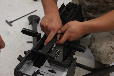 Lance Cpl. Christian Herbeck, a motor vehicle operator with 2nd Light Armored Reconnaissance Battalion, 2nd Marine Division, disassembles a Mk-19 automatic grenade launcher during a Machine Gunners Course at the Division Combat Skills Center aboard Camp Lejeune, N.C., April 15, 2015. During the course the Marines were trained how to properly disassemble, reassemble and maintain the M249 squad automatic weapon, the M240B machine gun, Browning M2 .50 caliber machine gun and the MK19 automatic grenade launcher. (U.S. Marine Corps photo by Pfc. David N. Hersey/Released)