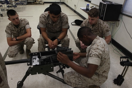 Lance Cpl. Trayon Bowleg, a light armored vehicle crewman with 2nd Light Armored Reconnaissance Battalion, 2nd Marine Division, disassembles a Mk-19 automatic grenade launcher during a Machine Gunners Course at the Division Combat Skills Center aboard Camp Lejeune, N.C., April 15, 2015. During the course the Marines were trained how to properly disassemble, reassemble and maintain the M249 squad automatic weapon, the M240B machine gun, Browning M2 .50 caliber machine gun and the MK19 automatic grenade launcher. (U.S. Marine Corps photo by Pfc. David N. Hersey/Released)