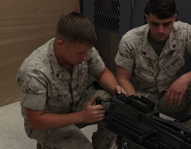 Lance Cpl. Zachary Miller, a motor vehicle operator with 2nd Light Armored Reconnaissance Battalion, 2nd Marine Division function checks a Mk-19 automatic grenade launcher during a Machine Gunners Course at the Division Combat Skills Center aboard Camp Lejeune, N.C., April 15, 2015. During the course the Marines were trained how to properly disassemble, reassemble and maintain the M249 squad automatic weapon, the M240B machine gun, Browning M2 .50 caliber machine gun and the MK19 automatic grenade launcher. (U.S. Marine Corps photo by Pfc. David N. Hersey/Released)