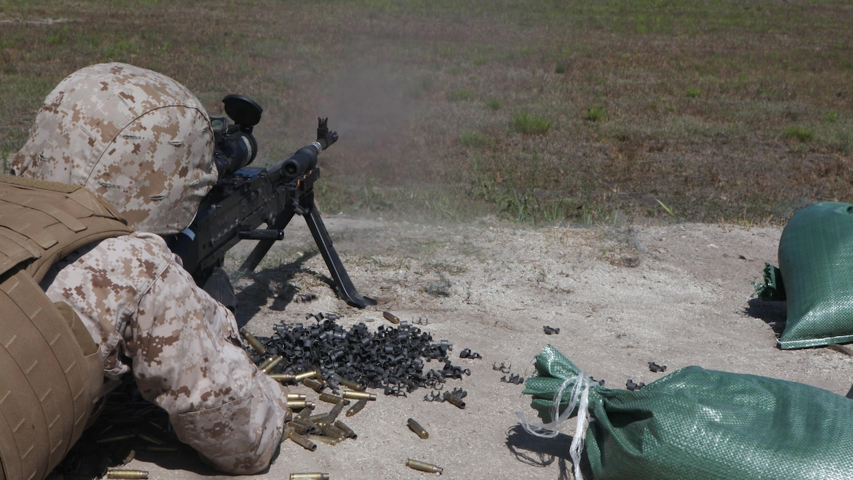 A Marine fires an M240B medium machine gun during the live-fire testing of the Machine Gunner's Course aboard Camp Lejeune, N.C., April 23, 2014. The course is one of the services offered to Marines by the Division Combat Skills Center and is a two-week course that familiarizes Marines with the M249 squad automatic weapon light machine gun, M240B medium machine gun, M2 .50-caliber heavy machine gun and the MK-19 40mm automatic grenade launcher.