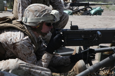 A Marine with the Machine Gunner's Course adjusts the aim of a M2 .50-caliber heavy machine gun during a live-fire exercise aboard Camp Lejeune, N.C., April 23, 2014. Targets were placed at various distances on the range, requiring the students in the course to adjust aim in order to hit the intended target. (U.S. Marine Corps photo by Pfc. David N. Hersey/Released)