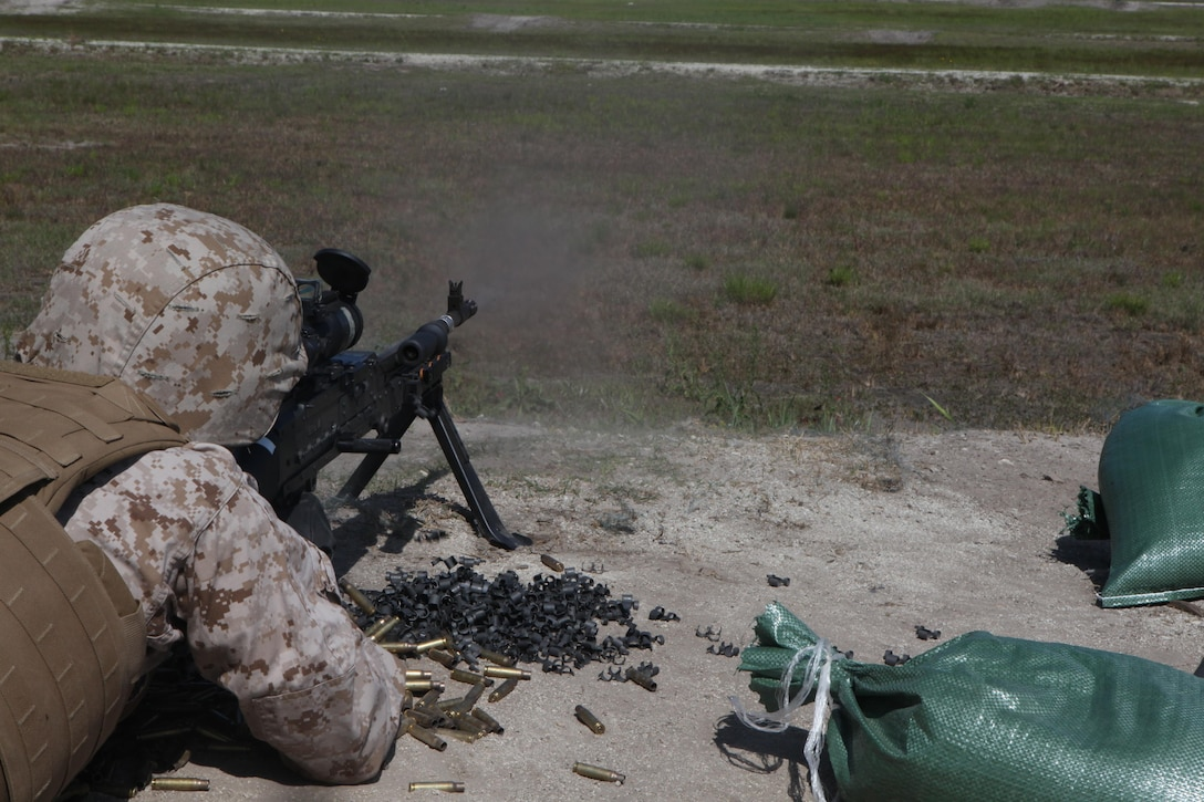A Marine fires an M240B medium machine gun during the live-fire testing of the Machine Gunner's Course aboard Camp Lejeune, N.C., April 23, 2014. The course is one of the services offered to Marines by the Division Combat Skills Center and is a two-week course that familiarizes Marines with the M249 squad automatic weapon light machine gun, M240B medium machine gun, M2 .50-caliber heavy machine gun and the MK-19 40mm automatic grenade launcher. (U.S. Marine Corps photo by Pfc. David N. Hersey/Released)