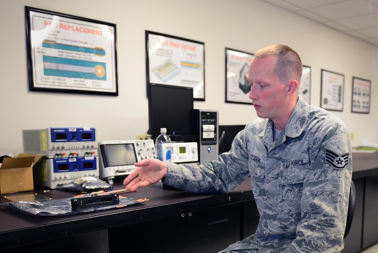 U.S. Air Force Staff Sgt. Paul Clark, 27th Special Operations Maintenance Group Air Force Repair Enhancement Program technician, reviews his process for repairing an LCD screen May 5, 2015 at Cannon Air Force Base, N.M. Clark trained in miniature and microminiature electronic repair, module test and repair, and electronic signal analysis courses before becoming a certified AFREP technician. (U.S. Air Force photo/Airman 1st Class Shelby Kay-Fantozzi)