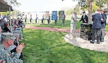 Brig. Gen. Eric J. Wesley, 1st Inf. Div. senior mission commander, greets members of the 16th Infantry Regiment Association after the unveiling of the 16th Infantry Vietnam Monument May 1.