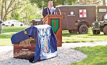 Retired Lt. Col. Steven Clay, president of the 16th Infantry Regiment Association, speaks to a group of veterans and active-duty Soldiers at the unveiling ceremony for the 16th Infantry Vietnam Monument May 1 on the grounds of Fort Riley's U.S. Cavalry Museum.