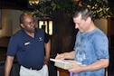 Air Force Reserve 910th Airlift Wing Chaplain Lt. Col. Klavens Noel talks with a participant during registration at a local Yellow Ribbon Program event at the Kalahari resort here, May 8, 2015. The 910th, based at nearby Youngstown Air Reserve Station, Ohio (YARS), hosted the May 8 – 10, 2015 event which was attended by more than 90 Citizen Airmen and their family members. The Yellow Ribbon Program is mandated by the U.S. Congress and is designed to provide tools to Servicemembers and their families to aid them before, during and after an extended military tour. (U.S. Air Force photo/Master Sgt. Bob Barko Jr.)