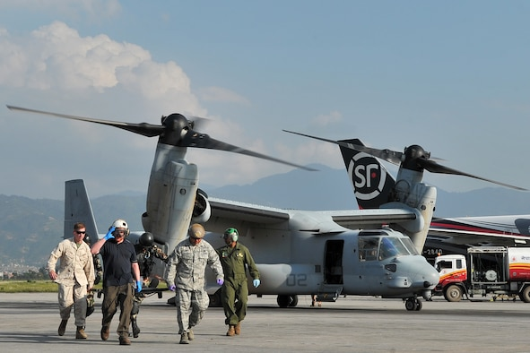 U.S. Air Force, Marines, and Nepalese army members transport an earthquake patient from a MV-22 Osprey for medical care at the Tribhuvan International Airport in Kathmandu, Nepal, May 12, 2015. The Joint Task Force-505 members worked with the Nepalese army to triage, treat and transport patients after a 7.3 magnitude earthquake struck the same day following a 7.8 magnitude quake that devastated the nation April 25, 2015. (U.S. Air Force photo by Staff Sgt. Melissa B. White/Released)