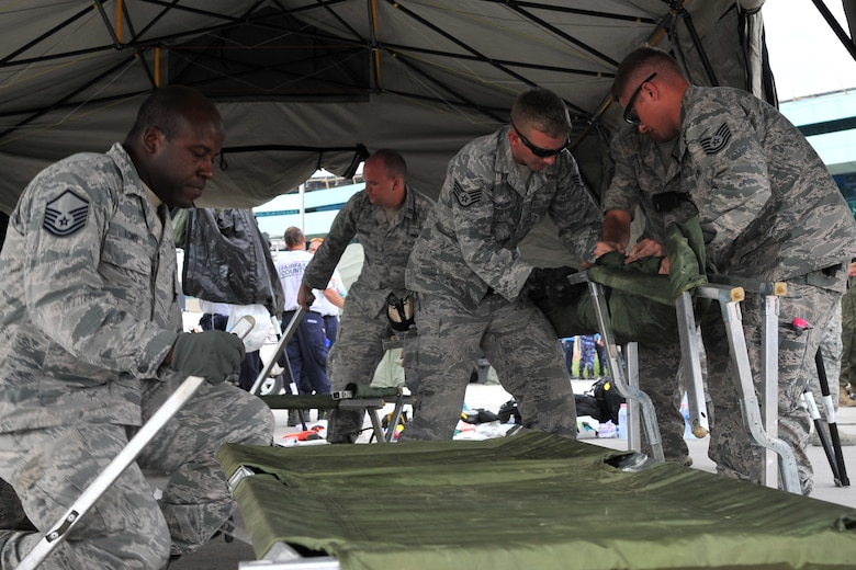 U.S. Airmen assigned to 36th Contingency Response Group set up a flightline aid station for medical professionals to take care of earthquake victims at the Tribhuvan International Airport in Kathmandu, Nepal, May 12, 2015. Joint Task Force-505 members worked with the Nepalese army to triage, treat and transport patients after a 7.3 magnitude earthquake struck the same day following a 7.8 magnitude earthquake that devastated the nation April 25, 2015. (U.S. Air Force photo by Staff Sgt. Melissa B. White/Released)