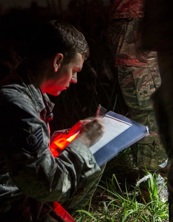 U.S. Air Force Tech. Sgt. Mark Hoover, an airfield manager with the 36th Contingency Response Group, Joint Task Force-505 and Naples, Florida native, writes down measurements used to determine the geotechnical engineering properties of the soil at the Tribhuvan International Airport, Kathmandu, Nepal, May 8, 2015. The team tested the soil using a dynamic cone penetrometer to determine its stability following the 7.8 magnitude earthquake that struck Nepal, April 25, 2015. The pavement evaluation tested to see if there were any significant changes to the soil beneath the runway since the earthquake. Any changes could restrict weight limitations to incoming flights in order to prevent any runway damage. JTF-505 works in conjunction with USAID and the international community to provide unique capabilities to assist Nepal. (U.S. Marine Corps photo by MCIPAC Combat Camera Staff Sgt. Jeffrey D. Anderson/Released)