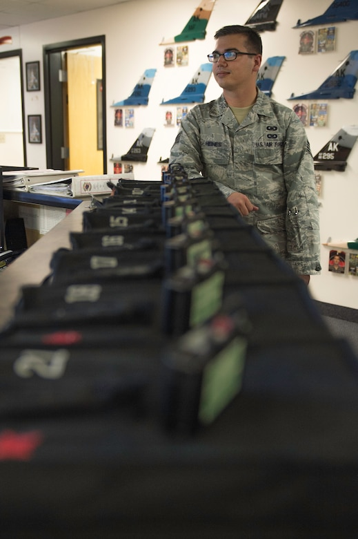 U.S. Air Force Staff Sgt. William Heines, an 18th Aggressor Squadron baron controller, checks the Red Flag-Alaska flight schedule at the squadron's operation desk May 12, 2015, at Eielson Air Force Base, Alaska. Baron controllers earn their title as experts in enemy aerial battle tactics from around the world who teach others how combat these threats. (U.S. Air Force photo by Staff Sgt. Shawn Nickel/Released)
