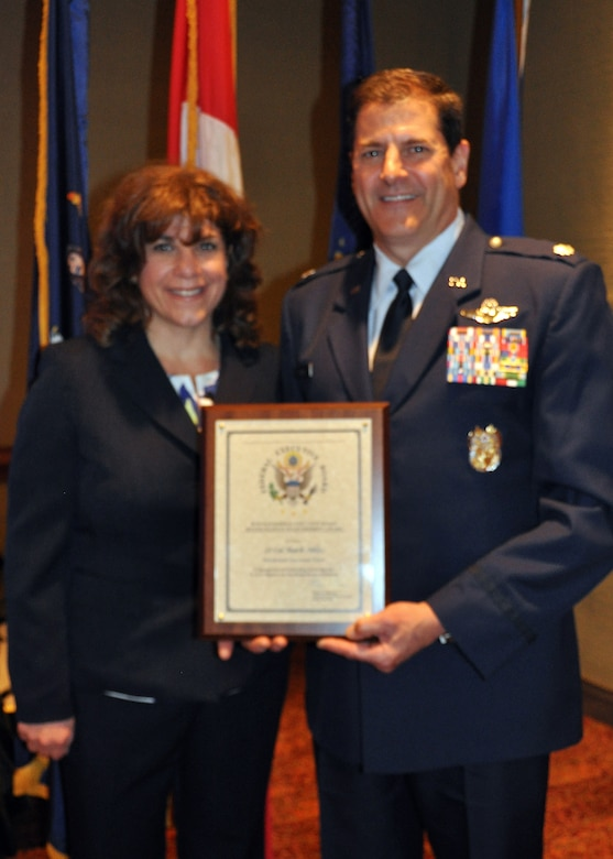 Lt. Col. Mark Ables, 914th Airlift Wing, poses with his wife Nancy after receiving the Distinguished Team Leader Award at the 2015 Excellence in Government awards luncheon May 5, 2015 in Buffalo, NY.  Ables was recognized for leading 80 plus team members through inspections, exercises, training and evaluations as the Wing Director of Inspections.  (Courtesy Photo)