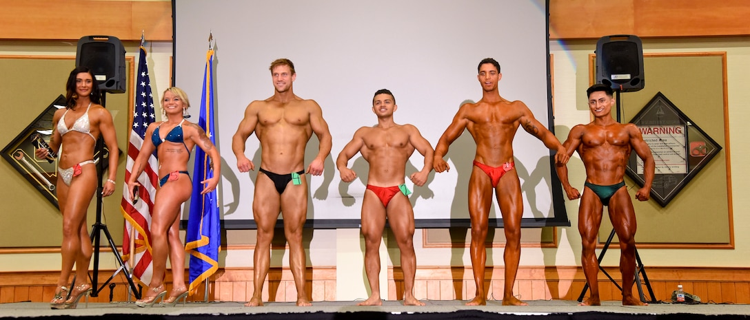 Contestants of Malmstrom Air Force Base's bodybuilding competition pose for the crowd during a final show-off at the Grizzly Bend May 8. During judging, competitors posed individually throughout a solo routine, as well as a group in the male and female categories. (U.S. Air Force photo/Airman 1st Class Collin Schmidt)