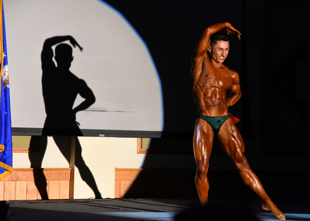 Senior Airman Christopher Almaraz, 819th RED HORSE Squadron structural journeyman, poses during a bodybuilding competition held at Malmstrom Air Force Base's Grizzly Bend, Mont., May 8. Almaraz prepared for the competition by following a strict diet, working out three times a day and practicing his posing for ten weeks prior to the event. (U.S. Air Force photo/Airman 1st Class Collin Schmidt)