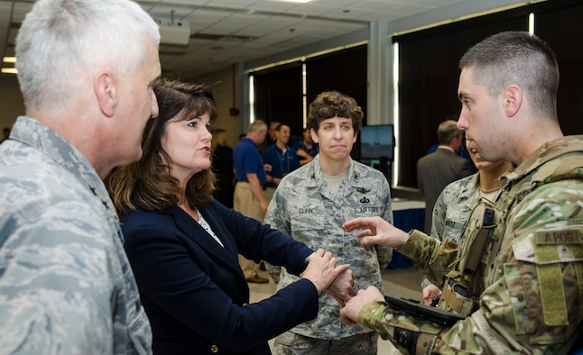 2nd Lt. Tony Eastin, behavioral scientist at Air Force Research Laboratory's 711th Human Performance Wing, and Dr. Mica Endsley discuss integrating consumer physiological sensors with AFRL's BATMAN suite of warfighting Airmen worn technologies. Dr, Endsley, the Air Force's chief scientist, joined AFRL commander, Maj. Gen. Tom Masiello, during a May review of technologies to be featured during the DoD Lab Day event May 14 at the Pentagon. (U.S. Air Force photo by Mikee Huber)