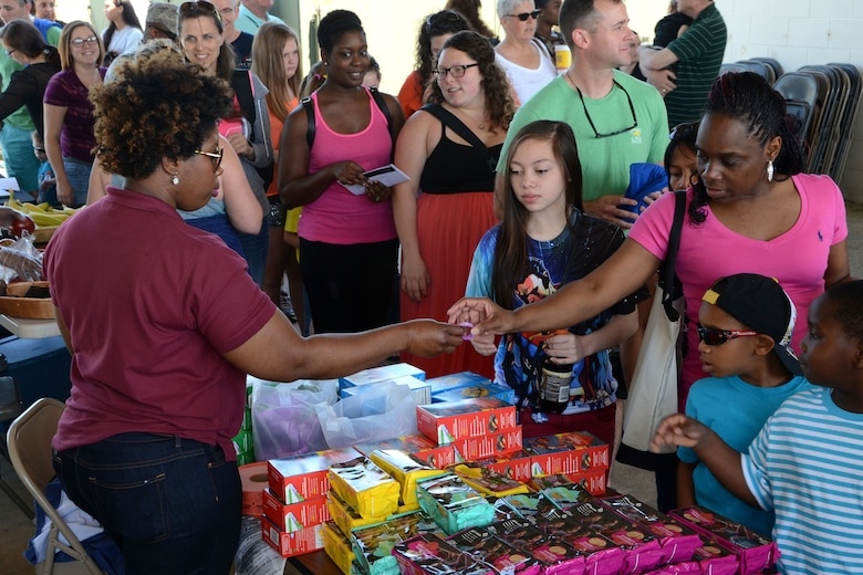 Swamp Fox Airmen and families gather for fun and fellowship during the 169th Fighter Wing Family Day at McEntire Joint National Guard Base, S.C., May 2, 2015. Local businesses and base support programs provided food and event activities to show their appreciation for the continued service of South Carolina Air National  Guard and 169th Fighter Wing families and Airmen. (U.S. Air National Guard photo by Amn Megan Floyd/Released)