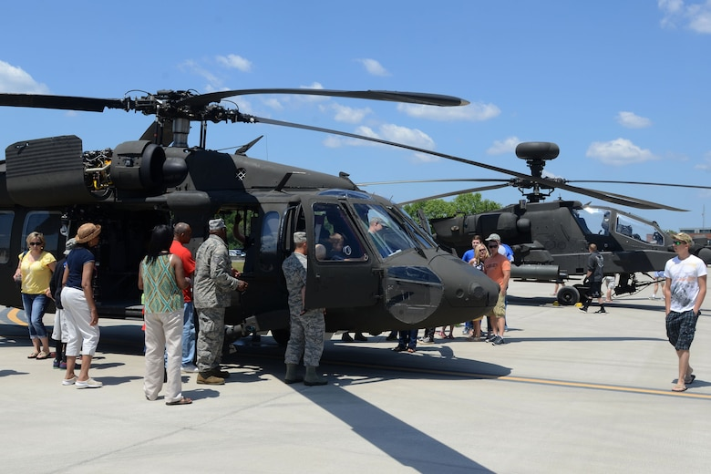 Swamp Fox Airmen and families gather for fun and fellowship during the 169th Fighter Wing Family Day at McEntire Joint National Guard Base, S.C., May 2, 2015. Local businesses and base support programs provided food and event activities to show their appreciation for the continued service of South Carolina Air National  Guard and 169th Fighter Wing families and Airmen. (U.S. Air National Guard photo by Senior Master Sgt. Edward Snyder/Released)