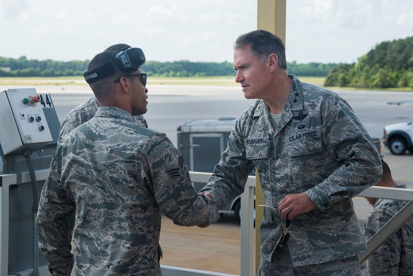 Maj. Gen. Kurt F. Neubauer speaks with Senior Airman Chris O'Grady, 437th Aerial Port Squadron ramp specialist, May 6, 2015, at Joint Base Charleston, S.C. Neubauer is the Air Force Chief of Safety, Headquarters U.S. Air Force, Washington, D.C., and Commander, Air Force Safety Center, Kirtland Air Force Base, N.M. He develops, executes and evaluates all Air Force aviation, ground, weapons, space and system mishap prevention, and nuclear surety programs to preserve combat readiness. In addition to touring Joint Base Charleston, Neubauer was the guest speaker at the Charleston Metro Chamber of Commerce's State of the Region: Salute to the Military event May 7, 2015 on the USS Yorktown at Patriot's Point in Mount Pleasant, S.C. (U.S. Air Force photo/Senior Airman George Goslin)