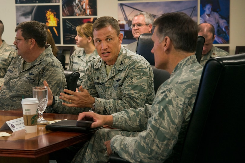 Colonel John Lamontagne, 437th Airlift Wing commander, briefs Maj. Gen. Kurt Neubauer on the wing's mission capabilities, May 6, 2015, at Joint Base Charleston, S.C. Neubauer is the Air Force Chief of Safety, Headquarters U.S. Air Force, Washington, D.C., and commander, Air Force Safety Center, Kirtland Air Force Base, N.M. He develops, executes and evaluates all Air Force aviation, ground, weapons, space and system mishap prevention, and nuclear surety programs to preserve combat readiness. In addition to meeting with senior leaders, Neubauer toured the 437th Aerial Port Squadron, the 437th Maintenance Squadron's Corrosion Control Facility, the 628th Civil Engineering Squadron's Explosives Ordnance Disposal unit as well as a tour of the Naval Nuclear Power Training Command and a windshield tour of other vital units located on the Weapons Station property. Neubauer also served as the guest speaker at the Charleston Metro Chamber of Commerce's State of the Region: Salute to the Military event May 7, 2015 on the USS Yorktown at Patriot's Point in Mount Pleasant, S.C. (U.S. Air Force photo/Senior Airman George Goslin)