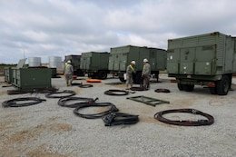 Members of the U.S. Army Corps of Engineers 249th Engineer Battalion, from Fort Belvoir, Va., work to hook up generators at Naval Support Facility Deveselu, Romania, April 18, 2015.
