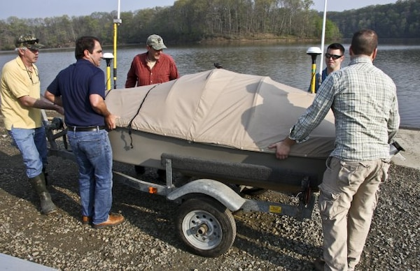 Pittsburgh district and ERDC staffs lift the USV off its trailer at the beginning of a day of surveying on Loyalhanna Lake in Western Pennsylvania.