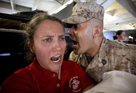 JOINT BASE LEWIS-MCCHORD, Wa. -- Anna Sigel, a Marine Corps officer candidate from Lancaster, Pennsylvania, responds to sergeant instructor Gunnery Sgt. Agustin Juradosegovia during Officer Candidates School preparation at Joint Base Lewis-McChord, Washington, May 8, 2015. During the three-day event, Seattle-based sergeant instructors and officer recruiters worked together to physically and mentally prepare candidates for the rigors of OCS, which the candidates will later attend aboard Marine Corps Base Quantico, Virginia. Juradosegovia is from Oxnard, California. (U.S. Marine Corps photo by Sgt. Reece Lodder)
