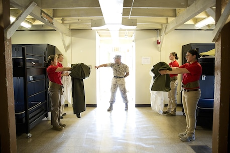 JOINT BASE LEWIS-MCCHORD, Wa. -- Gunnery Sgt. Agustin Juradosegovia, a sergeant instructor from Oxnard, California, prepares Marine Corps officer candidates to make their beds during Officer Candidates School preparation at Joint Base Lewis-McChord, Washington, May 8, 2015. During the three-day event, Seattle-based sergeant instructors and officer recruiters worked together to physically and mentally prepare candidates for the rigors of OCS, which the candidates will later attend aboard Marine Corps Base Quantico, Virginia. (U.S. Marine Corps photo by Sgt. Reece Lodder)