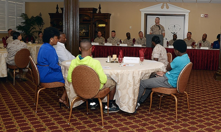 Master Sgt. William Tolleson addresses Marines and local school students during the annual Mentors in Action luncheon held May 14 at Town and Country Restaurant's Grand Ballroom aboard Marine Corps Logistics Base Albany. The students were the benefactors of more than 260 volunteer hours from Marines through the M.I.A. initiative.
