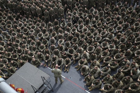 Lt. Col. Mike Wilonsky speaks to the Marines of Battalion Landing Team 2nd Battalion, 4th Marines on the flight deck of the USS Bonhomme Richard Feb. 22, 2015. Wilonsky used the opportunity to provide his guidance for the upcoming liberty port in Malaysia. The Marines are with BLT 2/4, 31st Marine Expeditionary Unit and recently concluded the annually scheduled Spring Patrol of the Asia-Pacific region. (U.S. Marine Corps photo by Lance Cpl. Ryan C. Mains/Released)