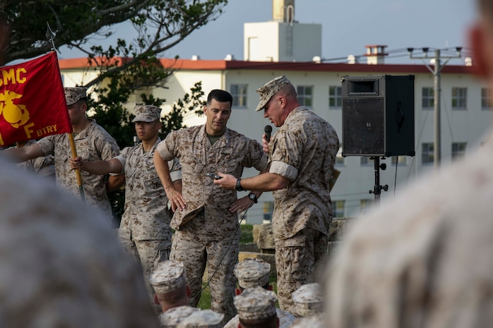 Lt. Col. Mike Wilonsky presents Col. Romin Dasmalchi a plaque during a battalion formation May 8, 2015. Dasmalchi is the commanding officer for the 31st Marine Expeditionary Unit and Wilonsky is the commanding officer for Battalion Landing Team 2/4, 31st MEU. The Marines are with BLT 2/4, 31st MEU, and they recently concluded the annually scheduled Spring Patrol of the Asia-Pacific region. (U.S. Marine Corps photo by Cpl. Ryan C. Mains/ Released)